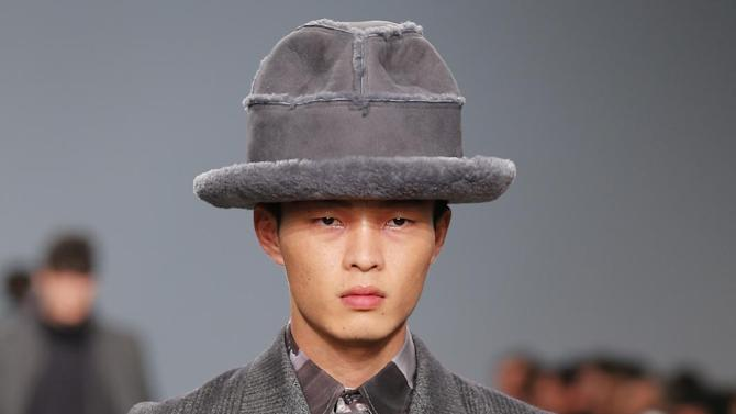 A model wears a creation by British fashion designer Bill Gaytten for John Galliano, as part of the men's fashion collection, presented in Paris, Friday, Jan. 18, 2013. (AP Photo/Jacques Brinon)
