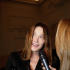 Carla Bruni Sarkozy speaks to the media as she arrives for Jean Paul Gaultier's Spring-Summer 2015 Haute Couture fashion collection, presented in Paris, France, Wednesday, Jan. 28, 2015. (AP Photo/Thibault Camus)