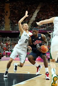 Lebron James drives the ball against Renaldas Seibutis during the Men's Basketball Preliminary Round (Getty Images)