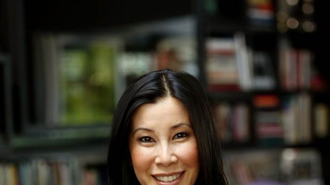 """In this May 10, 2013 photo, journalist Lisa Ling, poses for a portrait in Santa Monica, Calif. After giving birth to to 9-week-old daughter Jett, Ling says she's ready to get back to work with her Dove campaign to promote girl's self-esteem and her Oprah Winfrey Network series """"Our America with Lisa Ling."""" (Photo by Matt Sayles/Invision/AP)"""