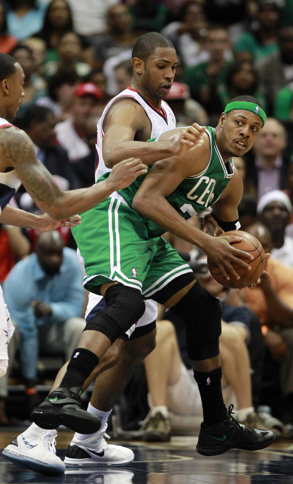 Boston Celtics small forward Paul Pierce (34) is covered by Atlanta Hawks center Al Horford (15) during the first half of Game 5 of an NBA first-round playoff series basketball game Tuesday, May 8, 2012, in Atlanta. (AP Photo/John Bazemore)