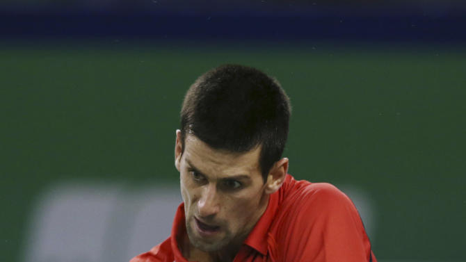 Novak Djokovic of Serbia returns a shot to Tommy Haas of Germany during the men's singles Quarterfinals match at the Shanghai Masters tennis tournament at Qizhong Forest Sports City Tennis Center in Shanghai, China, Friday Oct. 12, 2012. Djokovic won 6-3, 6-3. (AP Photo/Kin Cheung)