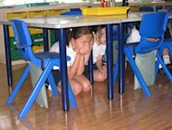 Children participating in an earthquake drill on April 23, 2009, at the British School in Tokyo.