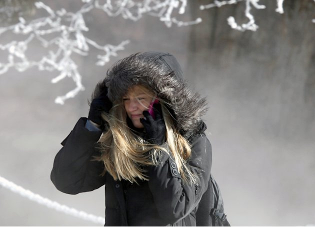 University of Wisconsin-Madison student Marisa Weich contends with sub-zero wind chill temperatures while making her way to class on the campus Tuesday, Jan. 22, 2013. (AP Photo/Wisconsin State Journa