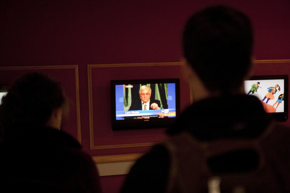 Students watch Virginia Tech president Charles Steger discuss the shooting of a Virginia Tech police officer on  Thursday, Dec. 8, 2011 at Squires student center on the school's Blacksburg, Va. campus. (AP Photo/The Roanoke Times, Sam Dean)