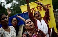&lt;p&gt;Indian women shout slogans during a protest against the entry of foreign retail chains outside the Agriculture Ministry in New Delhi on September 18. The government signed into law a decision late Thursday to allow foreign multibrand retailers to set up shop in India via joint ventures as it moved to further open up the economy and kickstart sharply slowing growth.&lt;/p&gt;