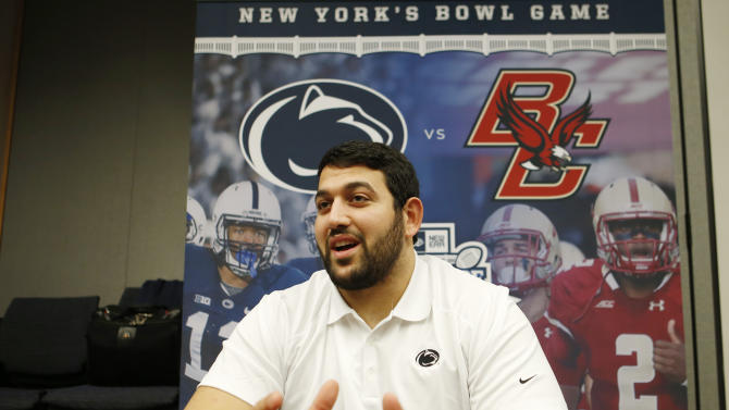 Penn State offensive lineman Angelo Mangiro speaks to members of the media during media day for Saturday's NCAA college football Pinstripe Bowl, Wednesday, Dec. 24, 2014, against Boston College at Yankee Stadium in New York. (AP Photo/Kathy Willens)