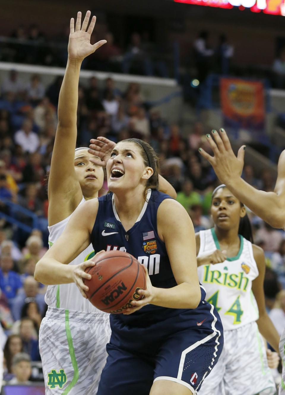 Connecticut center Stefanie Dolson (31) takes a shot against Notre Dame defense in the first half of the women's NCAA Final Four college basketball tournament semifinal, Sunday, April 7, 2013, in New Orleans. (AP Photo/Dave Martin)