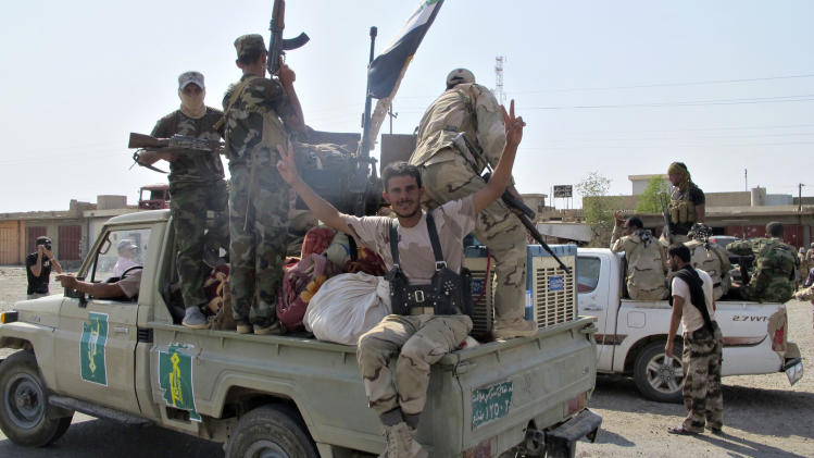 Iraqi security forces and Shi'ite militias react as they advance towards town of Amerli
