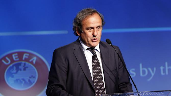 FILE- In this file photo dated Wednesday, Sept. 10, 2014, UEFA President Michel Platini speaks during the opening session of UEFA's Respect and Diversity conference against discrimination in European soccer, in Rome. It is announced Monday Dec. 29, 2014, that UEFA President Michel Platini is set to serve a third term after no rival candidate emerged before the deadline. (AP Photo/Riccardo De Luca, FILE)