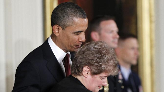 President Barack Obama awards posthumously the Medal of Honor to Rose Mary Sabo-Brown, widow of Specialist Leslie H. Sabo, Jr., US Army, Wednesday, May 16, 2012, during a ceremony in the East Room of the White House in Washington. Sabo was killed in 1970 in Cambodia during the Vietnam War. (AP Photo/Pablo Martinez Monsivais)