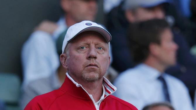 Coach of Serbia's Novak Djokovic, Boris Becker watches during his match against Kevin Anderson of South Africa at the Wimbledon Tennis Championships in London