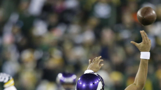 Minnesota Vikings quarterback Joe Webb (14) tries to throw the ball away as Green Bay Packers outside linebacker Erik Walden (93) tackles him during the first half of an NFL wild card playoff football game Saturday, Jan. 5, 2013, in Green Bay, Wis. (AP Photo/Jeffrey Phelps)