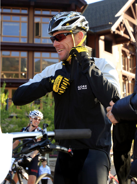 Lance Armstrong prepares to take part in the Power of Four mountain bicycle race at the starting line in Snowmass Village, Colo., early Saturday, Aug. 25, 2012. The race is the first public appearance