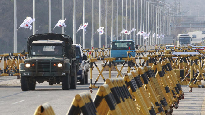 A South Korean military vehicle crosses Unification bridge, which leads to the demilitarized zone separating North Korea from South Korea near the border village of Panmunjom in Paju, South Korea, Friday, April 26, 2013. North Korea on Friday rejected a South Korean demand for talks on a jointly run factory park that has been closed nearly a month and said Seoul was free to withdraw its remaining citizens from the industrial complex if it wanted. (AP Photo/Ahn Young-joon)