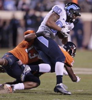 Renner leads Tar Heels past Virginia, 37-13
