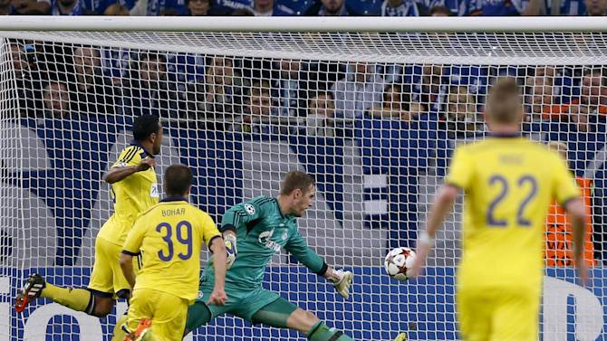 Maribor's Bohar scores past Schalke 04's Faehrmann in Champions League soccer match in Gelsenkirchen