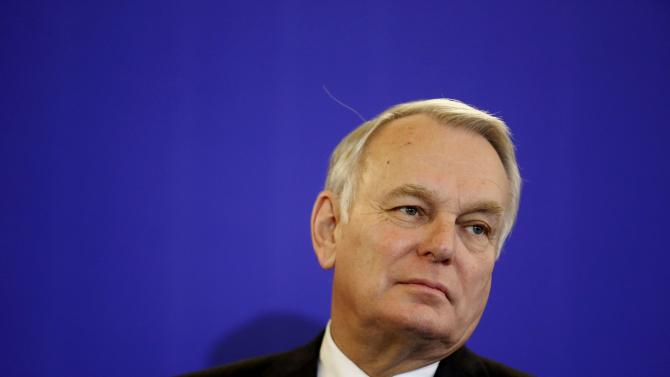 Newly-appointed French Foreign Minister Jean-Marc Ayrault attends a news conference during the official handover ceremony at the Quai d'Orsayin Paris