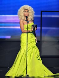 Nicki Minaj accepts the award for favorite album - rap/hip-hop Pink Friday: Roman Reloaded at the 40th Annual American Music Awards on Sunday, Nov. 18, 2012, in Los Angeles. (Photo by John Shearer/Invision/AP)