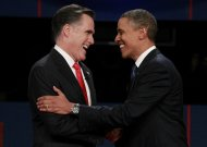 Republican presidential nominee Mitt Romney (L) shakes hands with President Barack Obama at the start of the first 2012 U.S. presidential debate in Denver October 3, 2012.   REUTERS/Jason Reed (UNITED STATES - Tags: POLITICS ELECTIONS USA PRESIDENTIAL ELECTION)