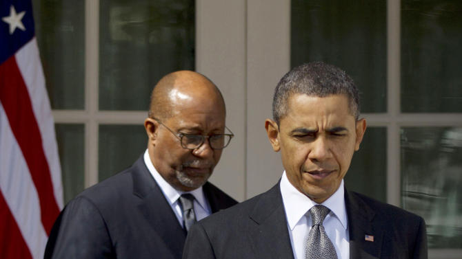 FILE - In this March 13, 2012 file photo, President Barack Obama and U.S. Trade Representative Ron Kirk, left, arrive to make a statement in the Rose Garden of the White House in Washington. The Obama administration has embarked on an aggressive trade agenda that could lower trade barriers and increase exports to many of the economic giants of Asia and Europe and hopes to wrap up talks by October 2013 on reducing duties on a wide range of goods and services in the Pacific, the world's most vibrant trading area. Eleven countries, including Australia, Peru, Malaysia, Vietnam, Mexico and Canada, are participating, and Japan has expressed interest in joining. (AP Photo/Pablo Martinez Monsivais, File)