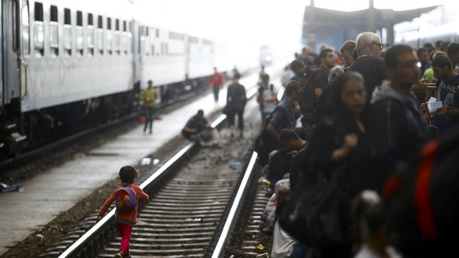 Migrants wait on a platform for a train at the Keleti train station in Budapest