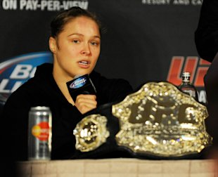 Ronda Rousey would be willing to fight at 145 lbs. again, but only against Gina Carano. (USA Today)