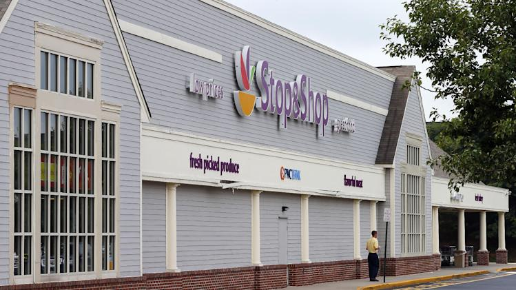 A man stands outside the Stop & Shop in South Brunswick, N.J., Thursday, Aug. 8, 2013, where one of the three winning Powerball tickets was sold. The jackpot is $448 million, the third largest ever. (AP Photo/Rich Schultz)