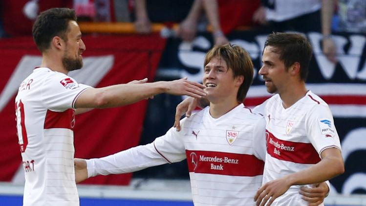 Stuttgart's Gentner, Sakai and Harnik celebrate Harnik's goal against Schalke 04 during their German Bundesliga first division soccer match in Stuttgart