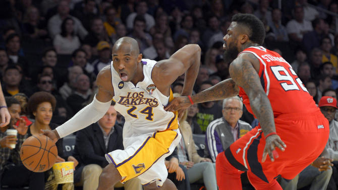 Los Angeles Lakers guard Kobe Bryant, left, drives toward the basket as Atlanta Hawks forward DeShawn Stevenson defends during the first half of their NBA basketball game, Sunday, March 3, 2013, in Los Angeles. (AP Photo/Mark J. Terrill)