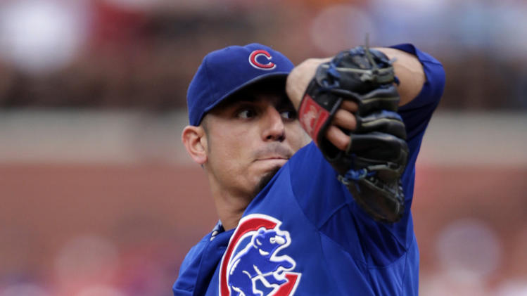Chicago Cubs starting pitcher Matt Garza delievers in the first inning of a baseball game against the against the St. Louis Cardinals, Saturday, July 21, 2012 in St. Louis. (AP Photo/Tom Gannam)