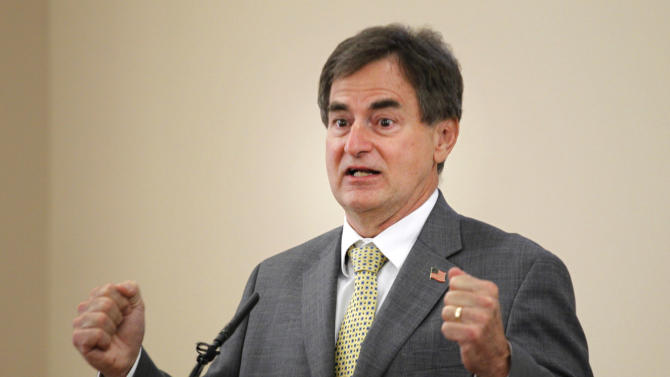 Republican U. S. Senate candidate Richard Mourdock urges his supporters to get to the polls on Tuesday as he makes a campaign stop Monday, May 7, 2012, at Immanuel Reformed Presbyterian Church near Battle Ground, Ind. Mourdock is running against incumbent Sen. Dick Lugar. (AP Photo/Journal & Courier)