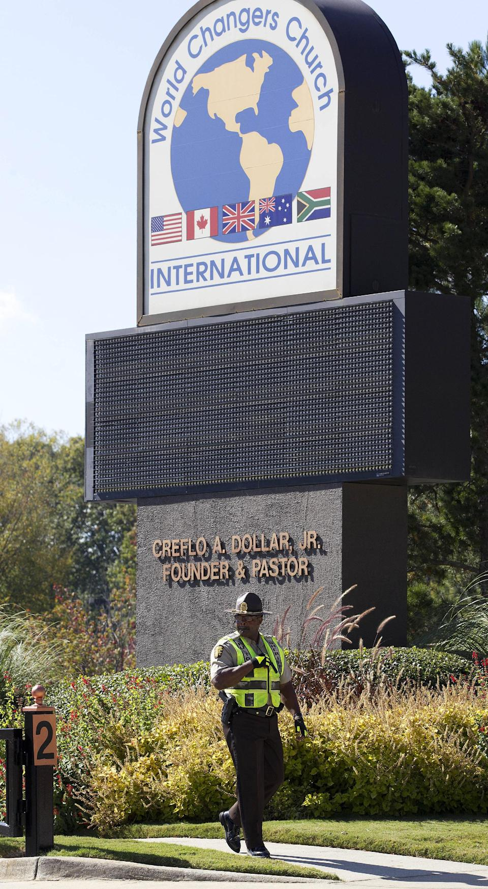 A Fulton County Sheriff's Deputy stands guard outside the World Changers International church in College Park, Ga., after a fatal shooting inside Wednesday, Oct. 24, 2012. Police say a volunteer leading a prayer service was shot and killed by a former church employee.  (AP Photo/John Bazemore)
