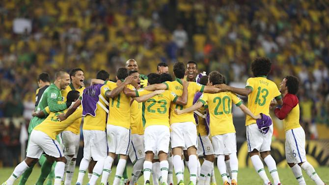 Brazil's players celebrate after beating 3-0 Spain during the soccer Confederations Cup final match at the Maracana stadium in Rio de Janeiro, Brazil, Sunday, June 30, 2013. (AP Photo/Andre Penner)