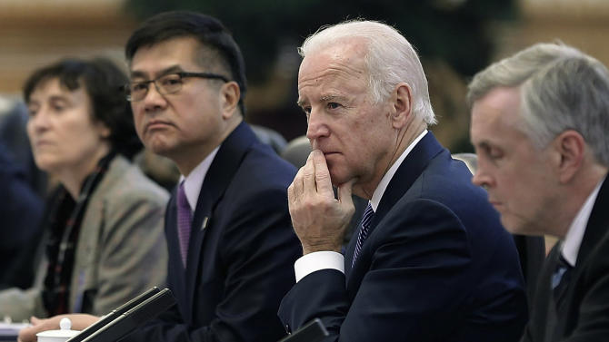 Vice President Joe Biden, center, listens during his meeting with Chinese President Xi Jinping inside the Great Hall of the People, Wednesday, Dec. 4, 2013, in Beijing, China. Biden and Xi discussed efforts to forge a new model for relations between the major powers, but they've made no public comments about a new Chinese air defense zone that's become a major friction point in Asia. (AP Photo/Lintao Zhang, Pool)