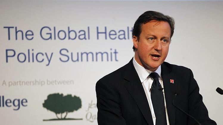 British Prime Minister David Cameron delivers a keynote speech to the delegates at the Global Health Policy Summit at the Guildhall in London, Wednesday, Aug. 1, 2012. The speech focus on life sciences ahead of the Global Investment Conference on Life Sciences on Thursday. (AP Photo/Sang Tan, Pool)