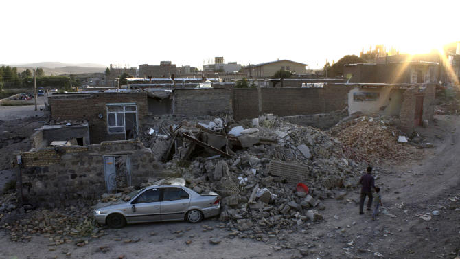 Ruins of a houses are seen after an earthquake in the city of Varzaqan in northwestern Iran, on Saturday, Aug. 11, 2012. A 6.2-magnitude earthquake hit the towns of Ahar, Haris and Varzaqan in East Azerbaijan province in northwestern Iran on Saturday, state TV said. Iran is located on seismic fault lines and is prone to earthquakes. It experiences at least one earthquake every day on average, although the vast majority are so small they go unnoticed. (AP Photo/Mehr News Agency, Hamed Nazari)