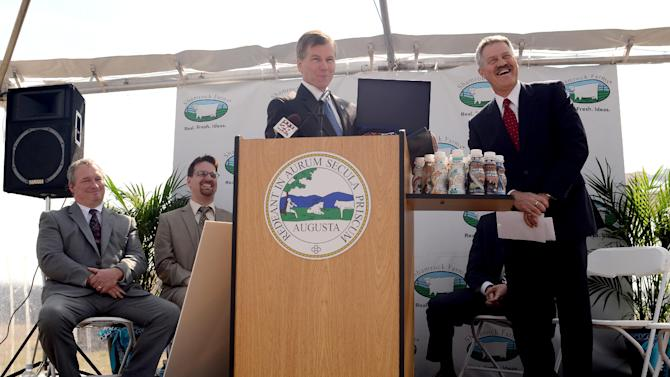 IMAGE DISTRIBUTED FOR SHAMROCK FARMS - In this image released on Monday, March 18, 2013, Shamrock CEO Kent McClelland, right, is presented a Virginia flag by Governor Bob McDonnell at the Augusta County Groundbreaking Event for Shamrock Farms, in Verona, Va. (Photo by Pat Jarrett/Invision for Shamrock Farms/AP Images)