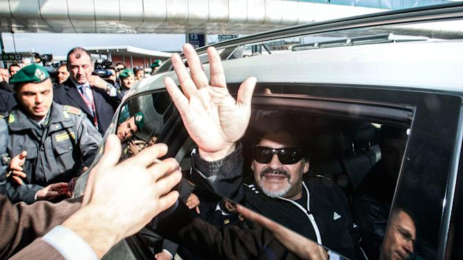 Maradona returns to Italy after 8-year tax exile