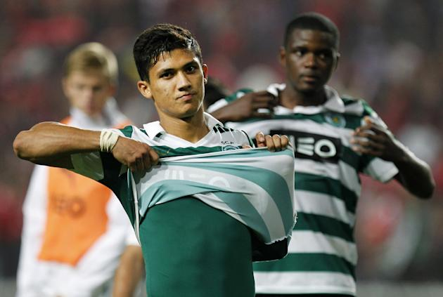 Sporting's Freddy Montero, from Colombia, takes off his shirt at the end of a Portugal Cup soccer match between Benfica and Sporting at Benfica's Luz stadium in Lisbon, Saturday, Nov. 9, 2013. Benfica