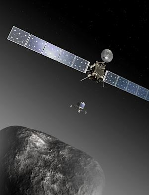 FILE - This image provided by the European Space Agency ESA shows an artist's impression of the Rosetta orbiter deploying the Philae lander to comet 67P/Churyumov–Gerasimenko. The image is not to scale; the Rosetta spacecraft measures 32 m across including the solar arrays, while the comet nucleus is thought to be about 4 km wide. Scientists at the European Space Agency are expecting their comet-chasing probe Rosetta to wake from almost three years of hibernation at 11 a.m. Monday Jan. 20, 2014 (1000 GMT; 5 a.m. EST) and phone home to say all is well. (AP Photo/ESA, C.Carreau, File)