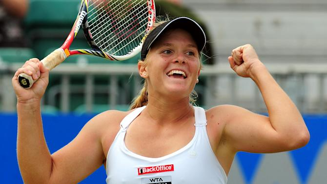 USA's Melanie Oudin celebrates defeating Serbia's Jelena Jankovic 6-4 6-2 in the final of the AEGON Championships at Edgbaston Priory Club, Birmingham England  Monday June 18, 2012. (AP Photo/ Rui Vieira/PA)  UNITED KINGDOM OUT