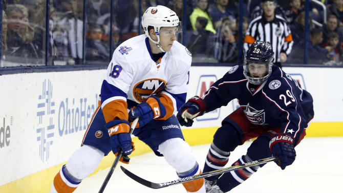 New York Islanders' Ryan Strome, left, looks for an open pass as Columbus Blue Jackets' Cody Goloubef defends during the first period of an NHL hockey game Tuesday, Feb. 9, 2016, in Columbus, Ohio. (AP Photo/Jay LaPrete)