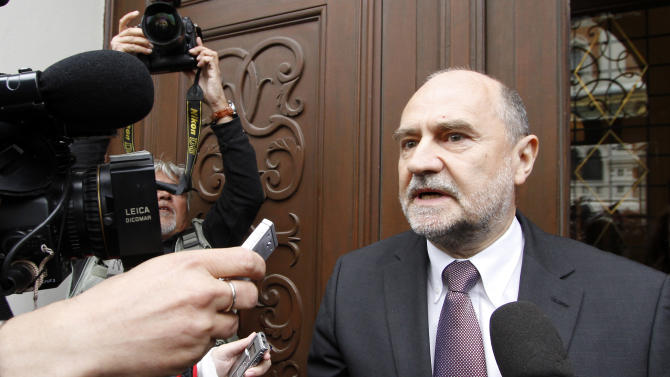 Herman Nackaerts, Deputy Director General and Head of the Department of Safeguards of the International Atomic Energy Agency, IAEA, talks to journalists as he arrives for talks with the Iran at the permanent mission of Iran in Vienna, Austria, Monday, May 14, 2012. The U.N. nuclear agency has started new talks with Iran aimed at getting access to what it suspects was the site of secret tests to make nuclear arms. (AP Photo/Ronald Zak)