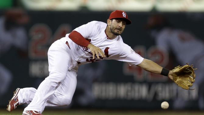 St. Louis Cardinals shortstop Daniel Descalso cannot reach a single by Milwaukee Brewers' Martin Maldonado during the fifth inning of a baseball game Friday, Sept. 7, 2012, in St. Louis. (AP Photo/Jeff Roberson)