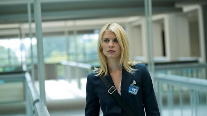 "In this image released by Showtime, Claire Danes portrays Carrie Mathison in a scene from the Showtime original series, "" Homeland."" Danes was nominated Thursday, Dec. 13, 2012 for a Golden Globe for best actress in a drama series for her role in "" Homeland .""  The 70th annual Golden Globe Awards will be held on Jan. 13. (AP Photo/Showtime, Kent Smith)"