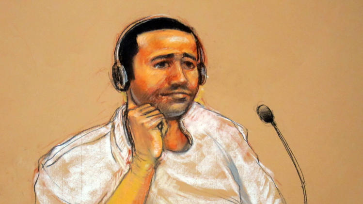 FILE - This Nov. 9, 2011, file artist rendering by courtroom artist Janet Hamlin, reviewed by the U.S. military, shows Abd Al Rahim Al Nashiri, accused of setting up the bombing of the USS Cole, depicted during his military commissions arraignment at the Guantanamo Bay detention center in Guantanamo, Cuba. Europe's top human rights court ruled Thursday, July 24, 2014, that Poland violated the rights of two terror suspects by allowing the CIA to secretly imprison them on Polish soil from 2002-2003 and facilitating the conditions under which they were subject to torture. (AP Photo/Janet Hamlin, File)