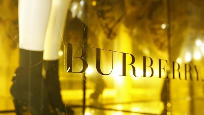 A mannequin is displayed in a window of Burberry's in central London