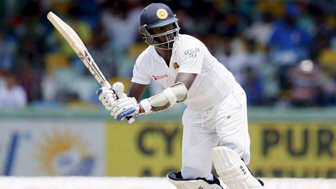 Sri Lanka's captain Mathews watches his shot during the final day of their third and final test cricket match against India in Colombo