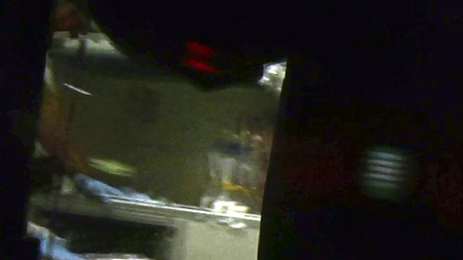 This still frame from video shows Boston Marathon bombing suspect Dzhokhar Tsarnaev visible through an ambulance after he was captured in Watertown, Mass., Friday, April 19, 2013. The 19-year-old college student wanted in the Boston Marathon bombings was taken into custody Friday evening after a manhunt that left the city virtually paralyzed and his older brother and accomplice dead.  (AP Photo/Robert Ray)